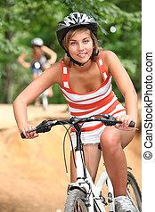 menina adolescente, ciclismo