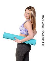 menina adolescente, segurando, esteira exercício