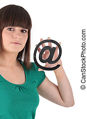 menina adolescente, segurando, símbolo