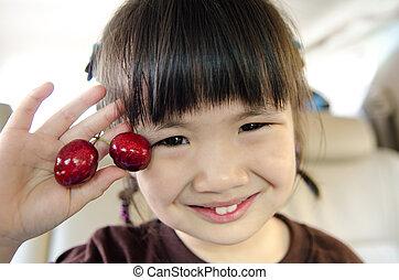 menina asiática, jovem, cereja