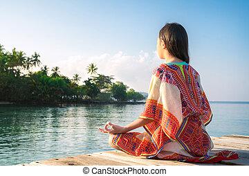 menina asiática, sentar, e, poste, posição ioga, ligado, a, recurso