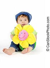 menina bebê, com, flor amarela