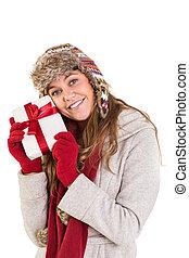 menina, inverno, segurando, roupas