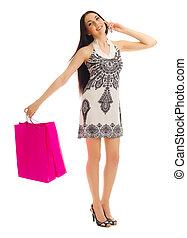 menina jovem, com, sacolas, conversas, por, telefone móvel