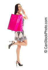 menina jovem, com, sacolas, e, telefone móvel
