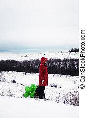 menina jovem, em, casaco vermelho, é, segurando, muito, de, luminoso, verde, bolas, s