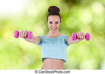 menina jovem, ginásio, fazendo, exercícios