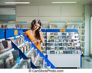 menina, loja música, escutar, cd