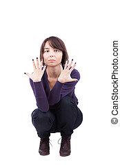 menina, mostrando, dedos, crouching