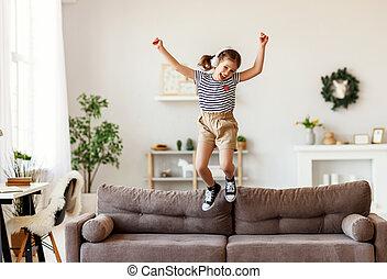 menina, sofá, música, pular, escutar, feliz