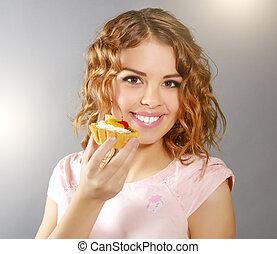 menina sorridente, cupcake