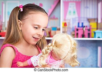 menina, tocando, com, boneca