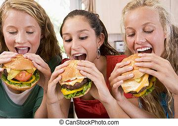 meninas, adolescente, comer, hambúrgueres