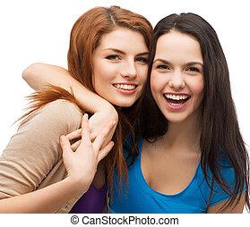 meninas, dois, abraçando, rir