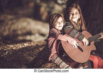 meninas jovens, violão jogo