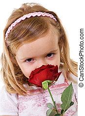 menininha, cheirando, um, rosa