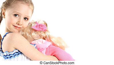 menininha, felizmente, abraçando, dela, bebê, doll., ligado,...