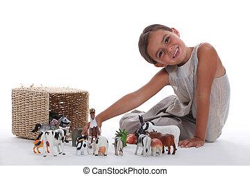 menininha, tocando, com, cultive animal, brinquedos