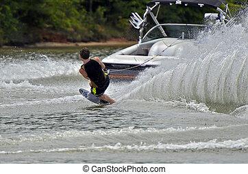 menino, água esquiando