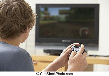 menino, adolescente, console, jogo, tocando