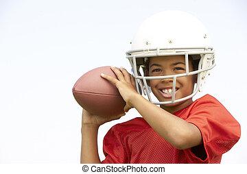 menino, futebol americano, jovem, tocando