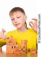 menino jovem, construir