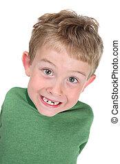 menino, sorrindo, dentes perdidos