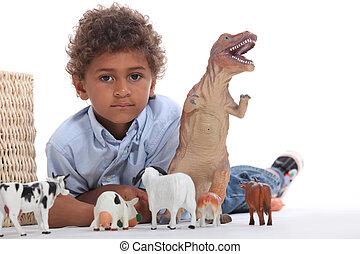menino, tocando, com, seu, brinquedos