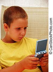 menino, tocando, jogo video