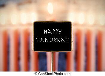 menorah and text happy Hanukkah in a chalkboard