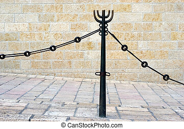 Menorah Jewish Symbol and Icon - A Menorah icon on a fence...