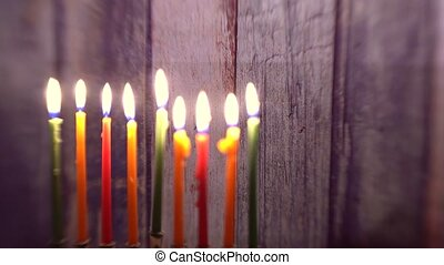 Menorah with candles for Hanukkah against defocused lights...
