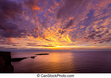 Menorca sunset in Cap de Caballeria cape at Balearic Islands...