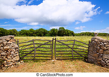 Menorca traditional wooden gate in spring at Balearic...