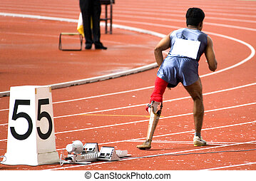 A participant getting ready in a men's 200 meters race for disabled persons.