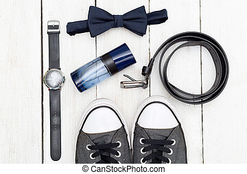 Men's accessories and shoes on a wooden background. Flat lay