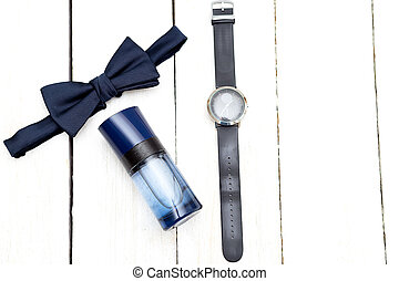 Men's accessories on a wooden background. Flat lay
