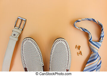Men's accessories on beige background. Top view.