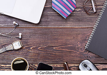 Men's accessories on wooden background.