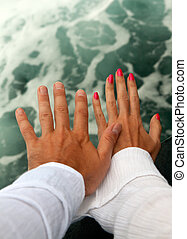 Men's and Women's tanned hands