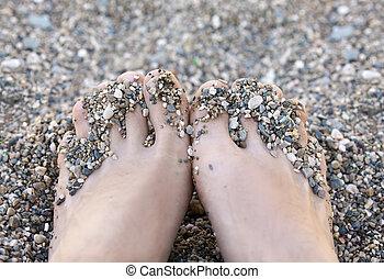 Men's barefoot on the beach
