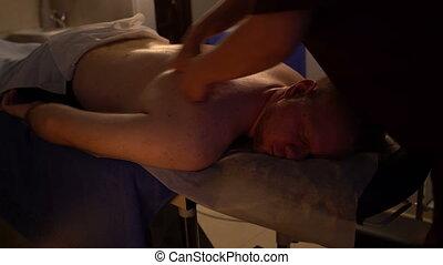 Men's beauty salon. Back massage.