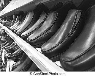 Men's Black Leather Shoes on Shelf