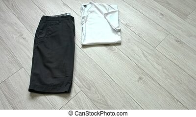 Men's casual outfits including dark blue shorts, white...
