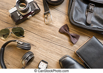 Men's casual outfits with accessories on on wood background...