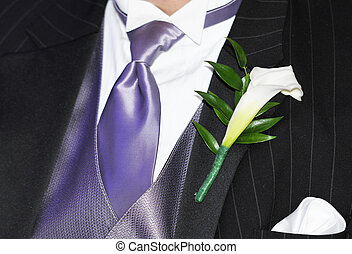 mens ceremonial suit with a piece of flower