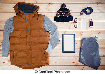 Men's clothes and accessories on a wooden background. Showcase of male store.