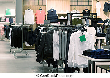 Mens clothes hanging on hangers in store