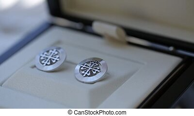 Men's cufflinks for a shirt on on the table Macro slider...