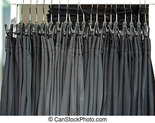 Mens dress pants trousers hanging in shop